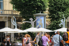 Tourists near the building of Opera and Ballet Theatre in Lviv. Lviv, Ukraine - July 5, 2014: Tourists near the building of Opera and Ballet Theatre in historic Stock Images