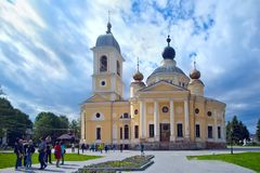 Tourists near the Cathedral of  Dormition in provincial town Mys Royalty Free Stock Photography