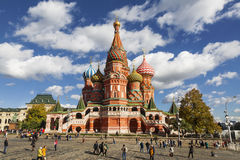 Tourists near Cathedral of Vasily the blessed on the Red square sunny autumn day. Moscow Stock Photo