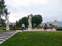 Tourists near the Catherine Palace in Tsarskoye Selo, Russia. Pushkin, St. Petersburg, Russia - August 7, 2017: Tourists near the Catherine Palace in Catherine Stock Images