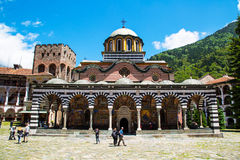 Tourists near the church in famous Rila Monastery Royalty Free Stock Image