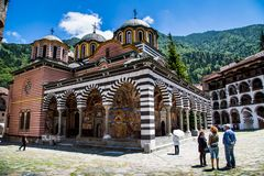 Tourists near the church in famous Rila Monastery Royalty Free Stock Photo