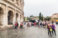Tourists near Colosseum monument in Rome city Royalty Free Stock Images