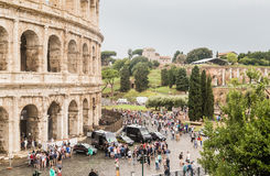 Tourists near Colosseum monument in Rome city Royalty Free Stock Image