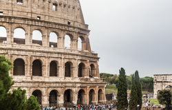 Tourists near Colosseum monument in Rome city Royalty Free Stock Photo