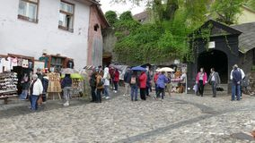 Tourists near covered stairway to the church in Old town of Sighisoara stock footage
