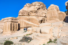 Tourists near Djinn Blocks in Bab as-Siq of Petra Royalty Free Stock Photo
