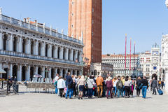 Tourists near Doge`s palace and campanile Royalty Free Stock Photos