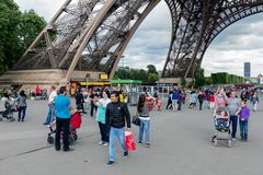 Tourists near the Eiffel tower, main attraction of Paris Royalty Free Stock Photo