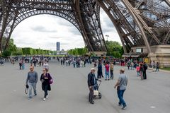 Tourists near the Eiffel tower, main attraction of Paris Stock Photography