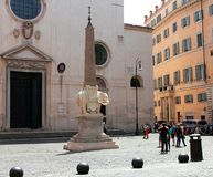 Tourists near Elephant and Obelisk by Bernini on square Piazza della Minerva in Rome royalty free stock images