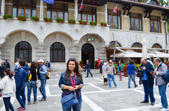Tourists  near the entrance of Limestone cave in Postojna. Tourists  near the entrance of  Postojna Cave (Slovene: Postojnska jama;  karst cave system near Royalty Free Stock Photography