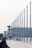 Tourists near flagpoles on Tiananmen Square Royalty Free Stock Photo