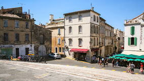 Tourists near gift shops on square in Arles Royalty Free Stock Images