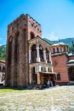 Tourists near the icon shop in famous Rila Monastery, Bulgaria Stock Images