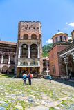 Tourists near the icon shop in famous Rila Monastery, Bulgaria Stock Photography