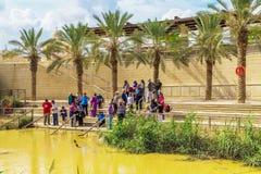 Tourists near Jordan River, at the site of Jesus' baptism Royalty Free Stock Image
