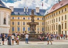 Tourists near Kohl`s Fountain in Prague Castle. Prague, Czech Republic Stock Images