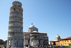 Tourists near leaning tower in Pisa, Italy. At this picture the restoration of the Leaning Tower of Pisa has just finished. The Torre pendente di Pisa is the Royalty Free Stock Photography