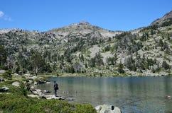 Tourists near the mountainous lake Royalty Free Stock Image