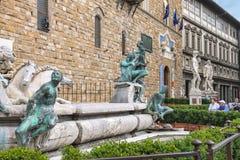 Tourists near Neptune fountain on Piazza della Signoria Royalty Free Stock Photos