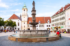 Tourists near Roland Fountain in Bratislava Stock Photo