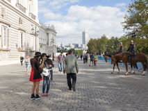 Tourists near the Royal Palace, Madrid Stock Images