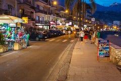 Tourists near shops in Giardini Naxos in night Royalty Free Stock Image