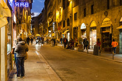 Tourists near shops on via Guicciardini in evening Royalty Free Stock Images
