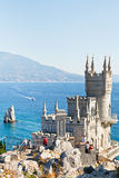 Tourists near Swallow's Nest castle in Crimea Royalty Free Stock Photo
