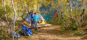 Tourists are near a tent on Lake Kardyvach. Russia, near Sochi Stock Image