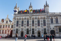 Tourists near a town hall in Bruges, Belgium Stock Images