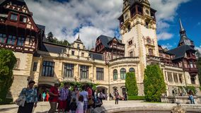 Tourists nearby Castle. Tourists visiting Peles Castle time lapse. People walking around the landmark and admire it stock video