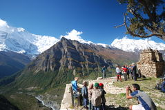Tourists and Nepali kids in the nature stock photos