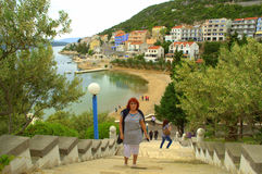 Tourists in Neum town,Adriatic coast. Tourists  enjoying the beautiful view of Neum town beach at spring day.Neum is Bosnia and Herzegovina only town located on Royalty Free Stock Photo