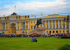 Tourists next to the Bronze Horseman and the Senate. Saint Petersburg, Russia - June 2016 Stock Images