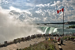Tourists at Niagara Horseshoe Falls. Tourists gather to view the Horseshoe Falls from the Table Rock Welcome Center, part of the Niagara Falls in Ontario, Canada royalty free stock image
