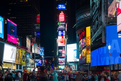 Tourists at night Times Square Stock Photography