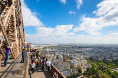 Tourists are on the observation deck of the Eiffel Tower in Pari Royalty Free Stock Photos