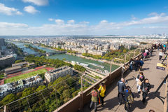 Tourists are on the observation deck of the Eiffel Tower in Pari Stock Photos