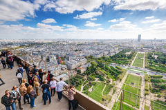 Tourists are on the observation deck of the Eiffel Tower in Pari Stock Image