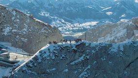 Tourists on Viewpoint on Mount Pilatus Top in Winter. Switzerland. Aerial View. Tourists on Observation Deck of Mount Pilatus Top in Winter Sunny Morning. Blue stock video