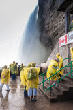 Tourists on observation deck in Niagara Falls. Tourists on observation deck of underground walkway underneath the Horseshoe falls in Niagara Falls, Canada. The stock photos
