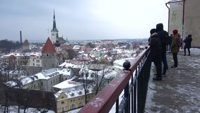 Tourists on the observation deck of the old Tallinn, gloomy March day. Estonia stock footage