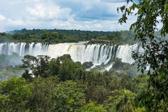 Tourists on observation deck watching Iguazu Falls Stock Image