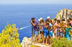 Tourists on the observation platform. Shipwreck Bay, Zakynthos Island, Greece - July 26, 2017: The queue of tourists on the observation platform, which offers a Stock Photos