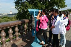 Tourists on the observation platform on Vorobyovy Gory Moscow the proud. Royalty Free Stock Photo
