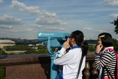 Tourists on the observation platform on Vorobyovy Gory Moscow the proud. Stock Photos