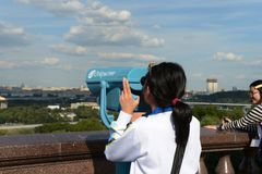 Tourists on the observation platform on Vorobyovy Gory Moscow the proud. Stock Photo