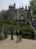 Tourists Observe Royal Palace in Sintra City, Portugal Royalty Free Stock Photo